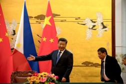 File photo of Philippine President Rodrigo Duterte shown the way by Chinese President Xi Jinping before a signing ceremony held in Beijing